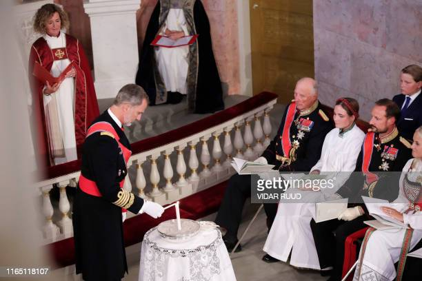 King Felipe of Spain lights candles during the confirmation ceremony of Princess Ingrid Alexandra at the Palace Chapel on August 31 2019 in Oslo...