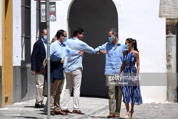 King Felipe of Spain performs an elbow bump with a well wisher during a visit to the Real Alcázar and Catedral de Sevilla on June 29, 2020 in...