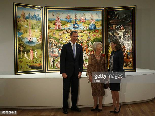 King Felipe of Spain Queen Letizia of Spain and Beatrix of the Netherlands stand in front of The Garden of Earthly Delights by Hieronymus Boschduring...