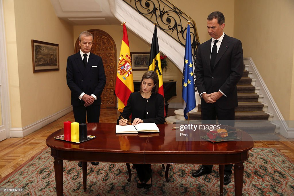 King Felipe of Spain (R), Queen Letizia (C) of Spain and Belgiam ambassador Pierre Labouverie (L) leave the Belgium Embassy after signing the book of condolences after terrorist attacks on March 23, 2016 in Madrid, Spain. Belgium is observing three days of national mourning after 34 people were killed in a twin suicide blast at Zaventem Airport and a further bomb attack at Maelbeek Metro Station. Two brothers are thought to have carried out the airport attack and an international manhunt is underway for a third suspect. The attacks come just days after a key suspect in the Paris attacks, Salah Abdeslam, was captured in Brussels.