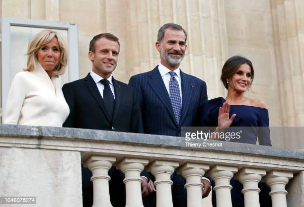 King Felipe of Spain Queen Letizia of Spain French President Emmanuel Macron and his wife Brigitte Macron pose for photographers before visiting the...