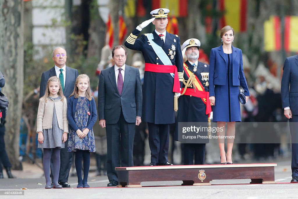 King Felipe of Spain (2R), Queen Letizia of Spain, Princess Leonor (2L) and Princess Sofia attend the National Day Military Parade 2015 on October 12, 2015 in Madrid, Spain.