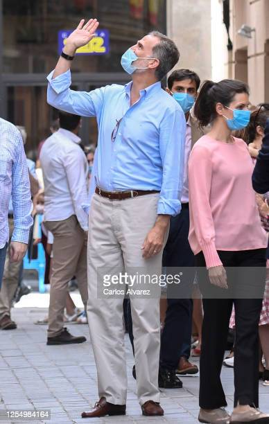 King Felipe of Spain waves to well wishers in the downtown area of Jaca on July 08 2020 in Jaca Spain This trip is part of a royal tour that will...