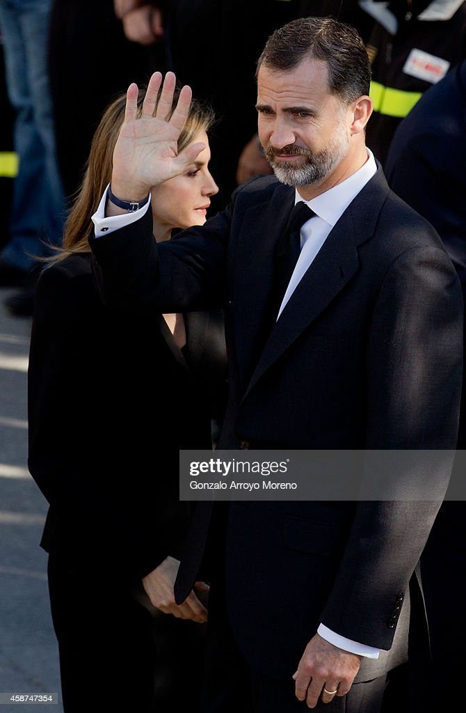 King Felipe (R) of Spain waves with his wife Queen Letizia after the funeral for the 14 victims of the recent bus accident at Juan Valera pavilion outdoors on November 10, 2014 in Bullas, at Murcia province, Spain. More than 2 thousand people attend the funerals for the 14 victims who were killed after their bus fell 15 meters from the Calasparra road. The travellers were returning from Madrid to the Murcian town of Bullas after attending a religious ceremony at the Convent of the Barefoot Carmelites.