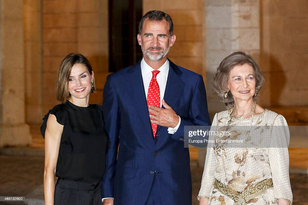 King Felipe (C), Queen Letizia (L) and Queen Sofia (R) attend a official reception at the Almudaina Palace on August 5, 2015 in Palma de Mallorca, Spain.