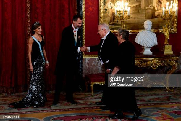 King Felipe VI and Queen Letizia of Spain greet Israeli President Reuven Rivlin and his wife Nechama Rivlin during a state dinner at the Royal Palace...