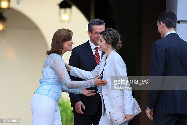 King Felipe VI and Queen Letizia of Spain salute Governor of Puerto Rico Alejandro Garcia Padilla and First Lady Wilma Pastrana as part of their...