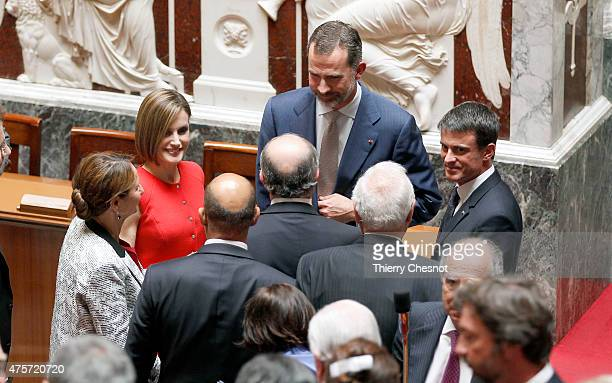 King Felipe VI and Queen Letizia of Spain speak with French Prime minister Manuel Valls and french deputy after his speech at the French National...