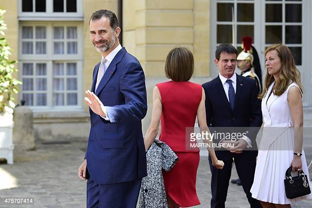 King Felipe VI and Queen Letizia of Spain wave goodbye to French Prime Minister Manuel Valls and his wife French violonist Anne Gravoin following...