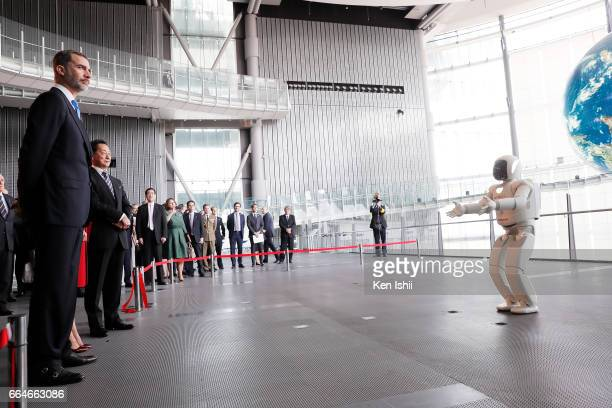 King Felipe VI looks on an ASIMO's performance during their visit to the National Museum of Emerging Science and Innovation on April 5 2017 in Tokyo...
