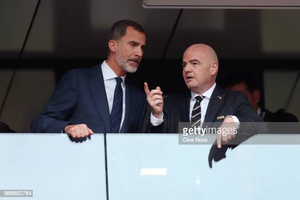 King Felipe VI of Spain and FIFA president Gianni Infantino are seen during the 2018 FIFA World Cup Russia Round of 16 match between Spain and Russia...