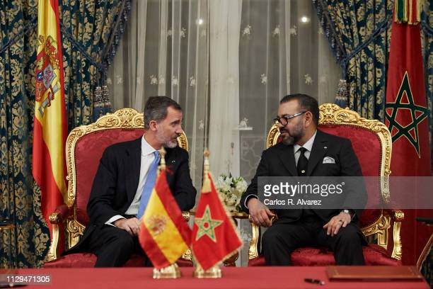 King Felipe VI of Spain and King Mohammed VI of Morocco attend the signing of bilateral agreements at the Agdal Royal Palace on February 13 2019 in...