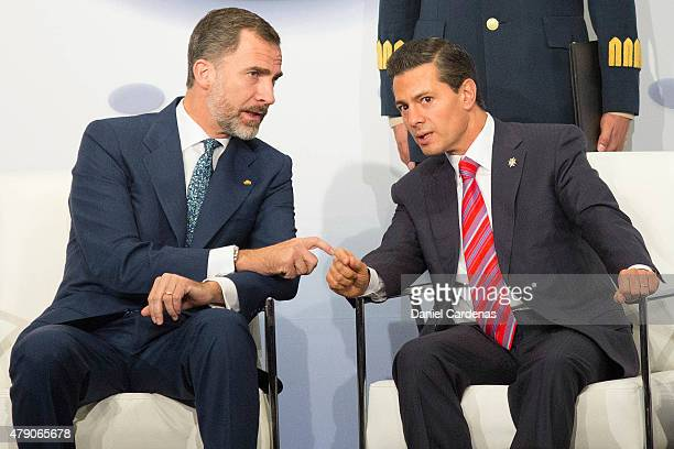 King Felipe VI of Spain and President of Mexico Enrique Peña Nieto talk during the Business Forum at Presidente Hotel on June 30 2015 in Mexico City...