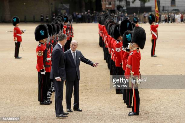 King Felipe VI of Spain and Prince Philip Duke of Edinburgh inspect a guard of honour with Britain's Prince Philip during a Ceremonial Welcome on...