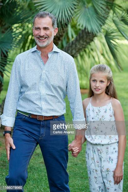 King Felipe VI of Spain and Princess Leonor of Spain pose for the photographers during the summer photocall at the Marivent Palace on August 04, 2019...