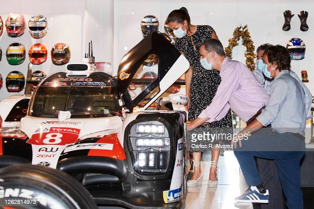 King Felipe VI of Spain and Queen Letizia of Spain are shown around by Fernando Alonso during a visit to the Fernando Alonso Museum and Circuit on...