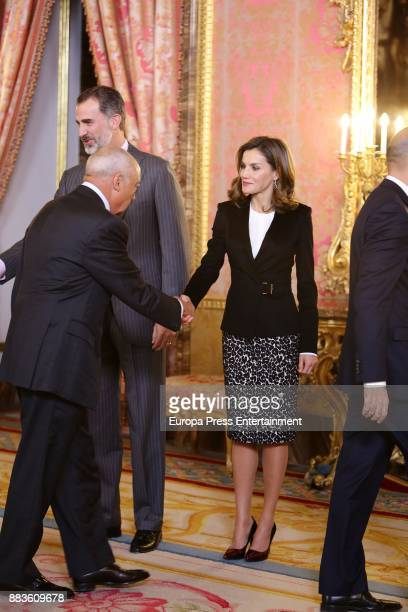 King Felipe VI of Spain and Queen Letizia of Spain attend a meeting with 'Princesa de Girona' Foundation members at the Royal Palace on December 1...