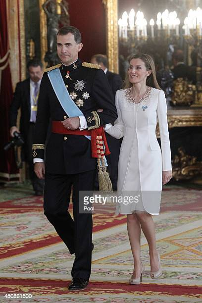 King Felipe VI of Spain and Queen Letizia of Spain attend a reception at the Royal Palace after the King's official coronation at the parliament on...