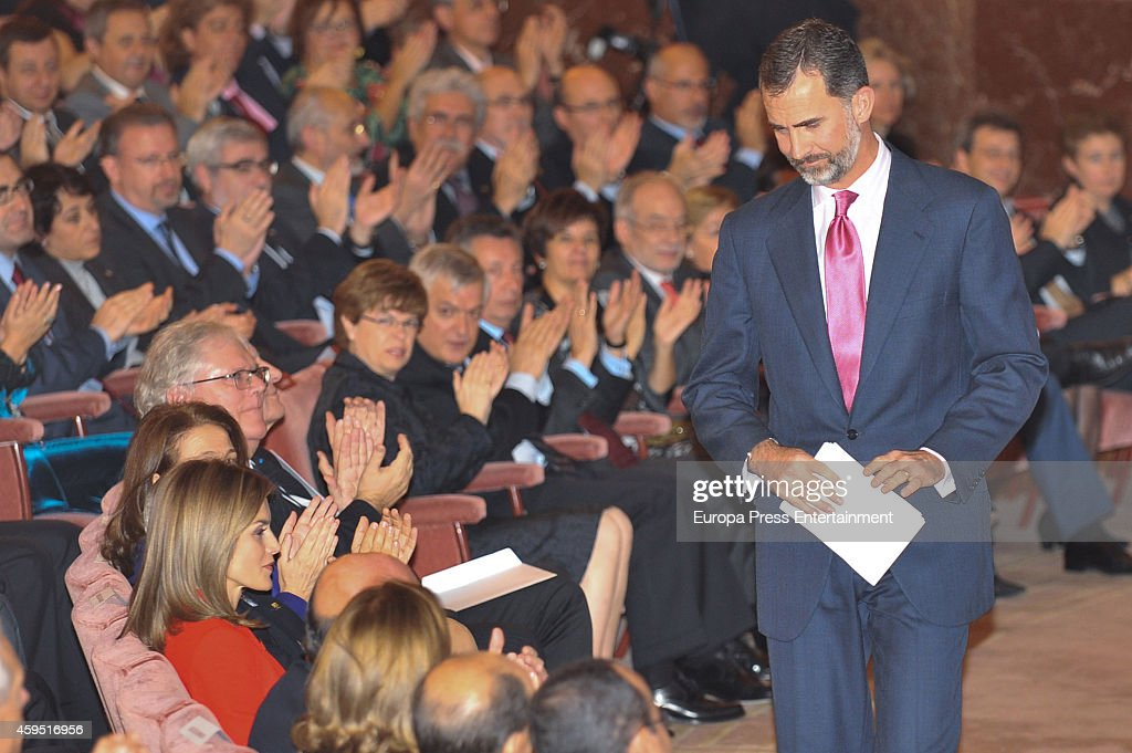 King Felipe VI of Spain (R) and Queen Letizia of Spain (wearing in red) attend the 75th aniversary of CSIC at CSIC headquarters on November 24, 2014 in Madrid, Spain.
