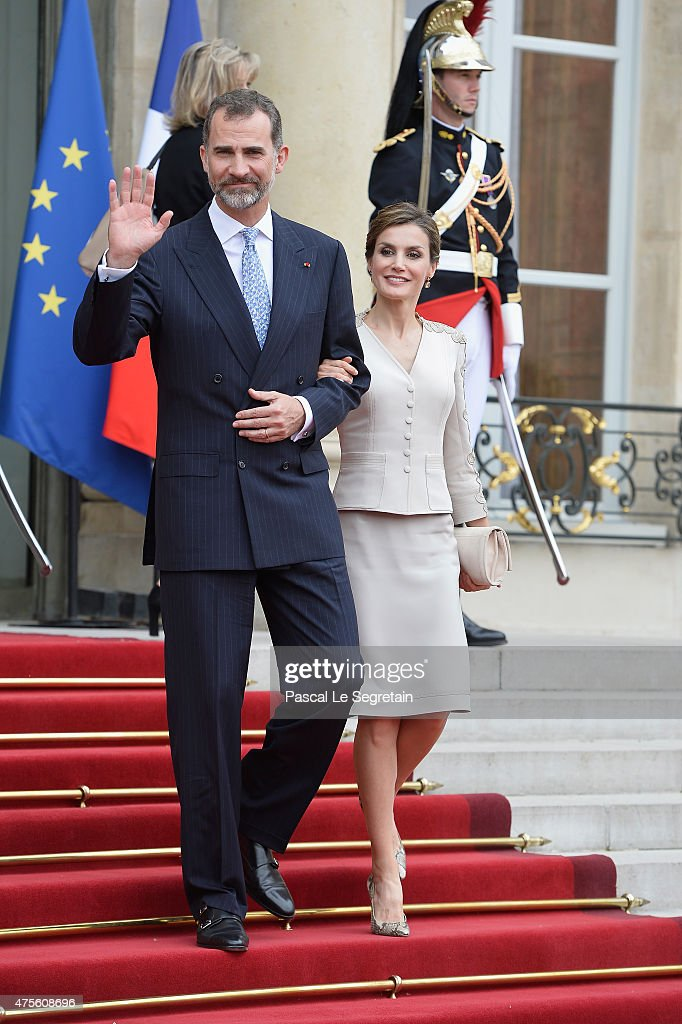 King Felipe VI of Spain and Queen Letizia of Spain depart from the Elysee Palace during the first day of the Spanish Royal couple's state visit on June 2, 2015 in Paris, France. Spain's King Felipe VI and Queen Letizia are on a three-day state visit, which had to be postponed last March following the Germanwings plane crash.