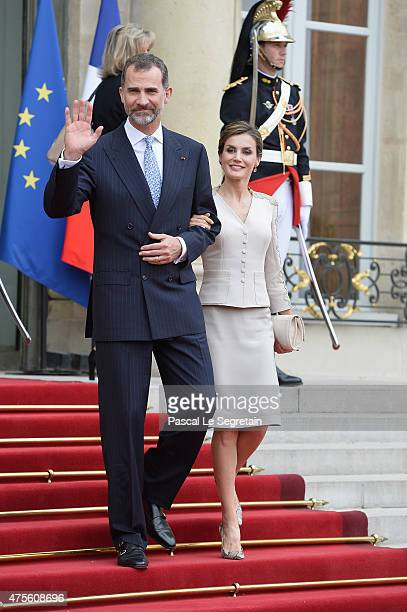King Felipe VI of Spain and Queen Letizia of Spain depart from the Elysee Palace during the first day of the Spanish Royal couple's state visit on...
