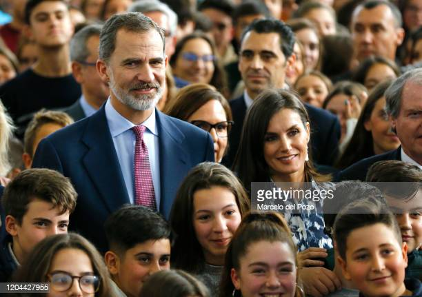 King Felipe VI of Spain and Queen Letizia of Spain pose with students and teachers during a visit to a school on February 06, 2020 in Ecija, Spain.