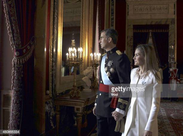 King Felipe VI of Spain and Queen Letizia of Spain prepare to appear at the balcony of the Royal Palace during the King's official coronation...