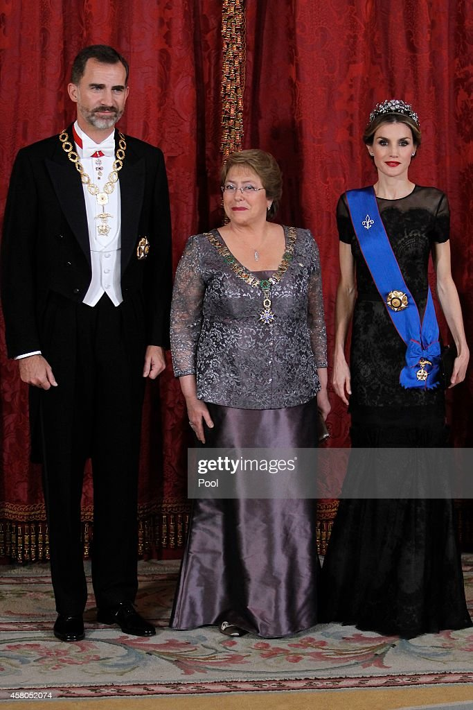 King Felipe VI of Spain (L) and Queen Letizia of Spain (R) receive Chilean President Michelle Bachelet (C) for a Gala dinner at the Royal Palace on October 29, 2014 in Madrid, Spain.
