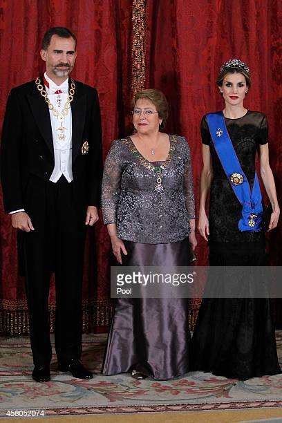 King Felipe VI of Spain and Queen Letizia of Spain receive Chilean President Michelle Bachelet for a Gala dinner at the Royal Palace on October 29...