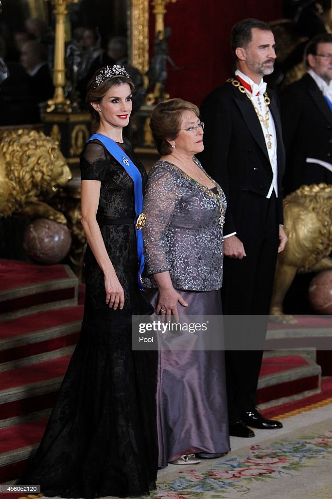 King Felipe VI of Spain (R) and Queen Letizia of Spain (L) receive Chilean President Michelle Bachelet (C) for a Gala dinner at the Royal Palace on October 29, 2014 in Madrid, Spain.