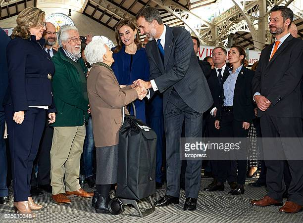 King Felipe VI of Spain and Queen Letizia of Spain visit the central market after the 'Rey Jaime I Awards' at Lonja de los Mercaderes on November 24...