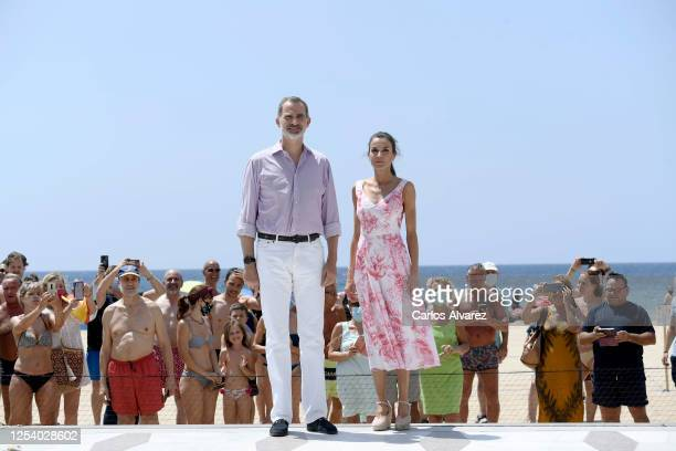 King Felipe VI of Spain and Queen Letizia of Spain walk through the seafront of Levante's beach on July 03, 2020 in Benidorm, Spain. This trip is...