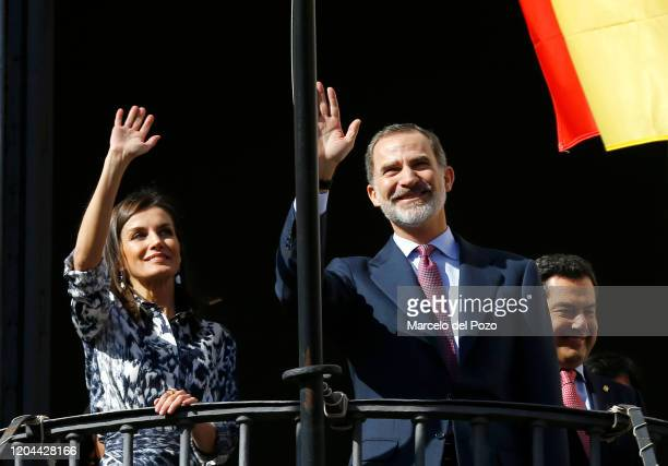 King Felipe VI of Spain and Queen Letizia of Spain wave from a balcony on February 06, 2020 in Ecija, Spain.