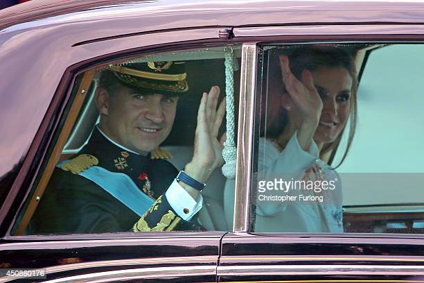 King Felipe VI of Spain and Queen Letizia of Spain wave to crowds as they leave the Royal Palace after the King's official coronation ceremony on...