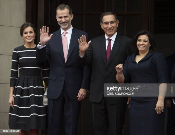 King Felipe VI of Spain and Queen Letizia pose for pictures with Peru's President Martin Vizcarra and First Lady Maribel Diaz upon their arrival at...