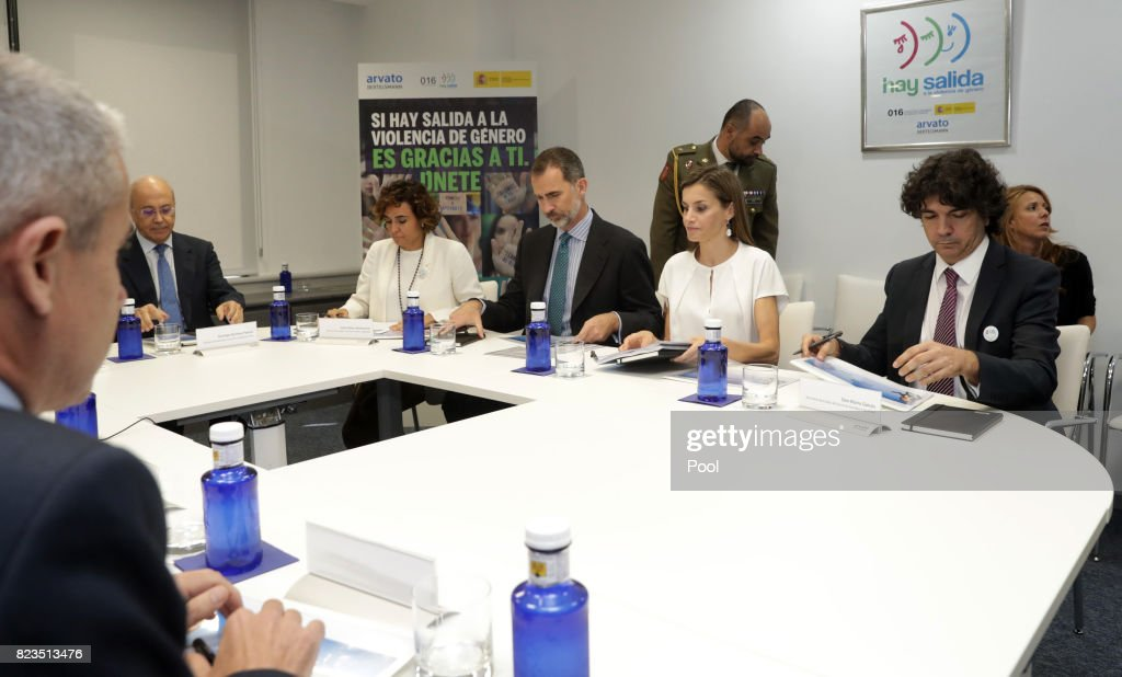 King Felipe VI of Spain and Queen Letizia sit with Minister of Health, Dolors Montserrat, (L) and State for Social Services and Equality, Mario Garcés, (R) during a visit to the offices of the 016 Telefonic hotline for gender violence assistance on July 27, 2017 in Madrid, Spain.