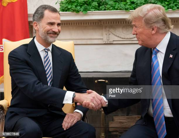 King Felipe VI of Spain and US President Donald Trump shakes hands during a meeting at The White House on June 19 2018 in Washington DC