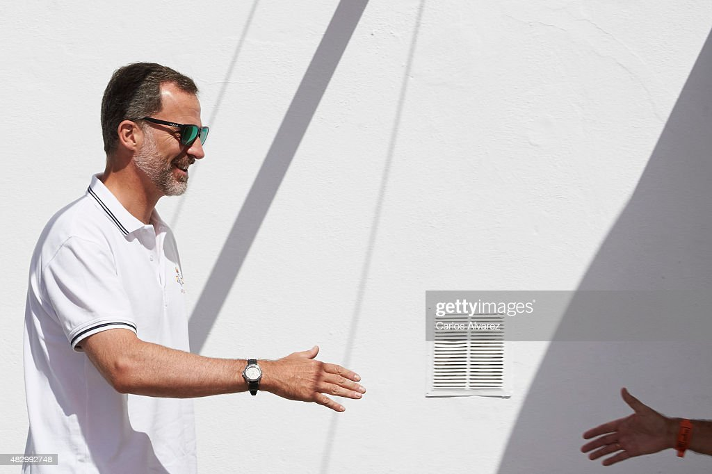 King Felipe VI of Spain (L) arrives at the Royal Nautical Club during the 34th Copa del Rey Mapfre Sailing Cup day 3 on August 5, 2015 in Palma de Mallorca, Spain.
