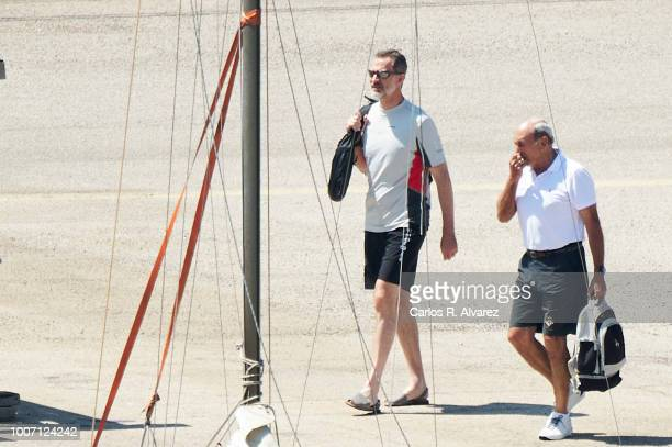 King Felipe VI of Spain arrives to the Aifos yacht for a training day at Puerto Pi on July 29 2018 in Palma Spain July 29 2018 in Palma de Mallorca...
