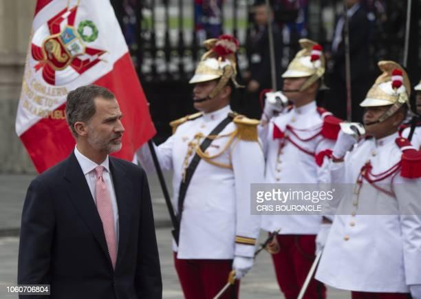 King Felipe VI of Spain arrives with Queen Letizia at the Government Palace in Lima on November 12 2018 for a meeting with Peru's President Martin...