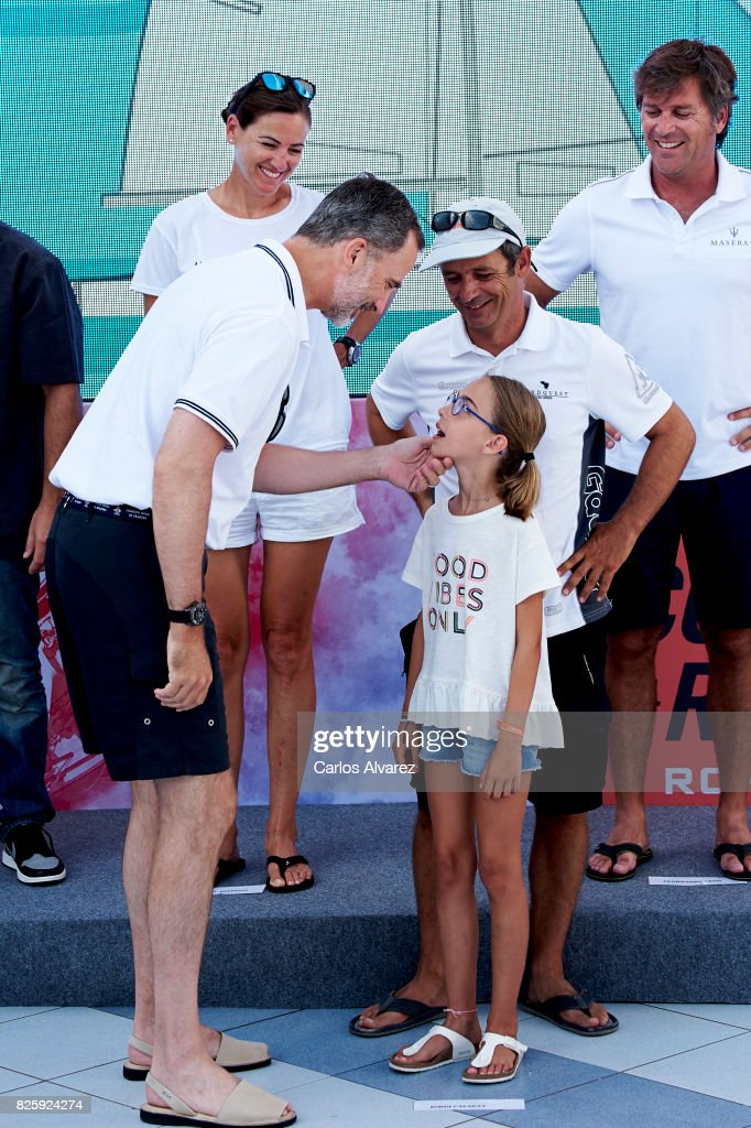 King Felipe VI of Spain (L) attends a tribute to the Olympic Sailors of Barcelona'92 during the 36th Copa Del Rey Mafre Sailing Cup at the Royal Nautic Club of Palma on August 3, 2017 in Palma de Mallorca, Spain.