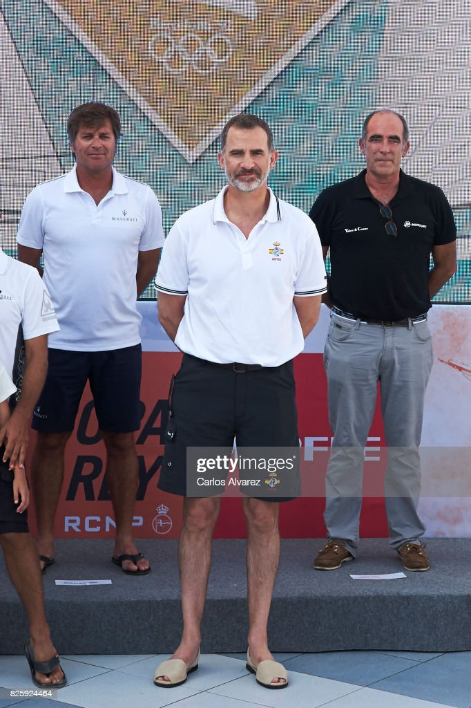 King Felipe VI of Spain (C) attends a tribute to the Olympic Sailors of Barcelona'92 during the 36th Copa Del Rey Mafre Sailing Cup at the Royal Nautic Club of Palma on August 3, 2017 in Palma de Mallorca, Spain.