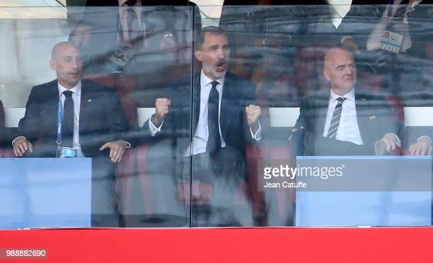 King Felipe VI of Spain celebrates the goal of Spain between President of Spanish Football Federation RFEF Luis Rubiales and FIFA President Gianni...