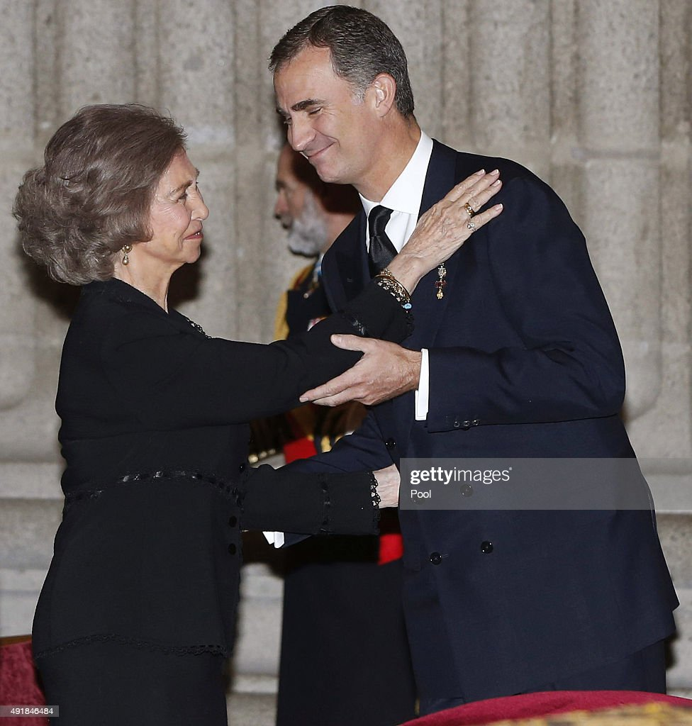 King Felipe VI of Spain greets his mother Queen Sofia of Spain as they arrive at El Escorial Monastery for a Corpore Insepulto Mass of Spain's Duke of Calabria, Carlos de Borbon Dos Sicilias on October 8, 2015 in San Lorenzo de El Escorial, Spain. Carlos de Borbon was born in 1938 and attended school with King Juan Carlos, where they became very good friends. He ranked first in the line of succession after the descendants of Don Juan Carlos and Queen Sofia.