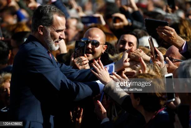King Felipe VI of Spain greets people on February 06, 2020 in Ecija, Spain.