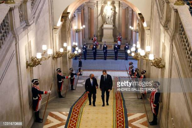 King Felipe VI of Spain greets Portuguese President Marcelo Rebelo de Sousa upon his arrival for a meeting at the Royal Palace in Madrid on March 12,...