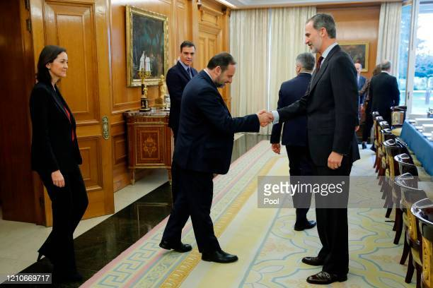 King Felipe VI of Spain greets Spanish Minister of Transport Mobility and Urban Agenda José Luis Ábalos as Spanish Prime Minister Pedro Sanchez looks...