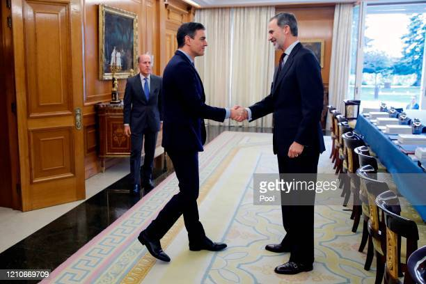 King Felipe VI of Spain greets Spanish Prime Minister Pedro Sanchez before the start of the meeting of the National Security Committee held at...