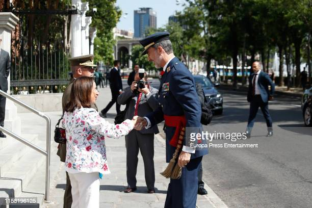 King Felipe VI of Spain is seen greeting the minister of Defense, Margarita Robles , during his visit to the Higher School of The Armed Forces on...