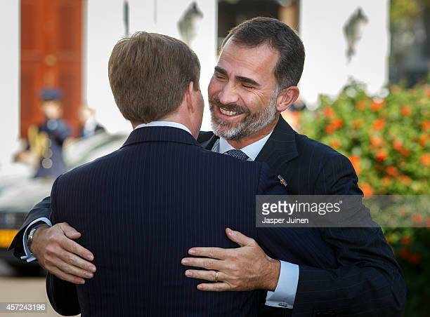 King Felipe VI of Spain is welcomed by King WillemAlexander of the Netherlands upon his arrival to Noordeinde palace on October 15 2014 in The Hague...